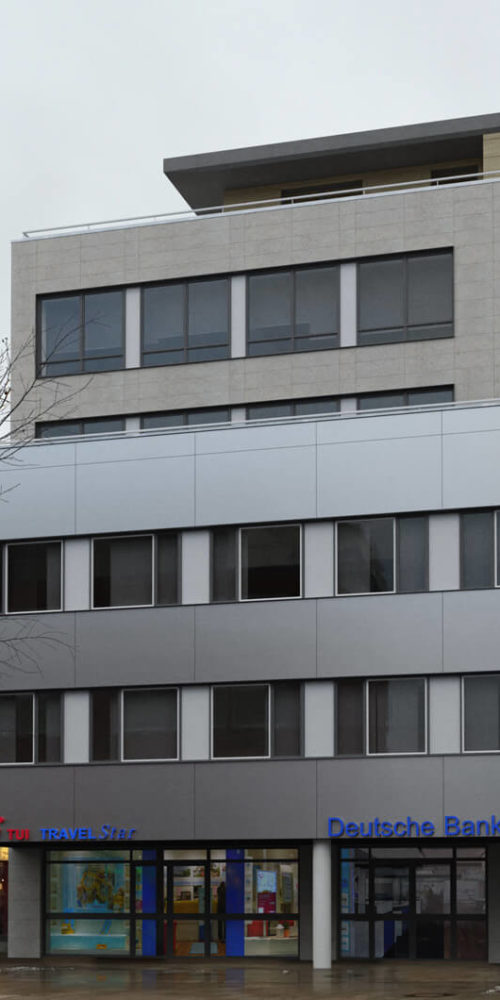 Porschestraße-wolfsburg-fotomontage-büro-gebäude-einkaufsstraße-baulücke-3d-visualisierung-architekturvisualisierung-pure3d-bielefeld